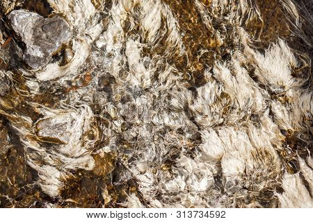 Background And Textured Of Albumen In Clear Natural Hot Spring Watercourse Caused By The Cracking Of