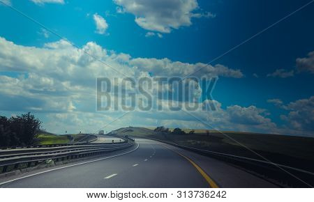 Russian Asphalt Roads. Highway. Road Trip. The Car Goes On The Road. Background Asphalt Road.