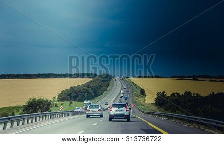 Russian Asphalt Roads. Highway. Road Trip. The Car Goes On The Road. Background Asphalt Road.