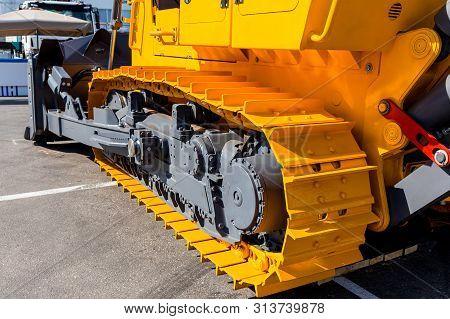 Image Of A Large New Yellow Bulldozer. Fragment Of A Caterpillar Bulldozer.powerful Construction Mac