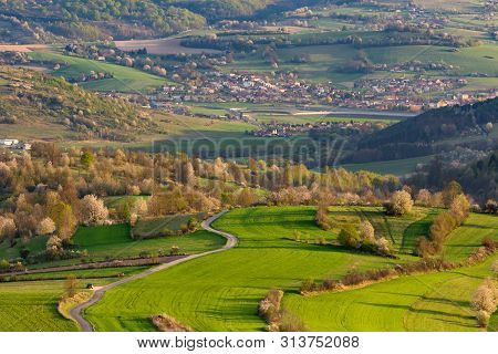 Spring In Slovakia. Meadows And Fields Landscape Near Hrinova. Spring Colored Cherry Trees At Sunset