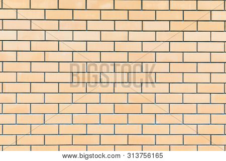 The Backround Or Texture Of Ideal Nice Yellow, Beige Or Brown Brick Wall Of The Building Or Edifice
