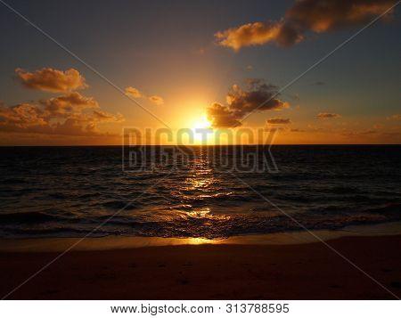 Sunrise Over Pacific Ocean In Waimanalo Beach On Oahu, Hawaii.