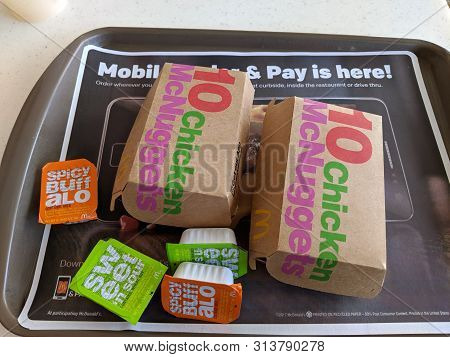 Waikiki - July 19, 2018: Two Ten Piece Chicken Mcnuggets On A Tray With Dipping Sauces Spicy Buffalo