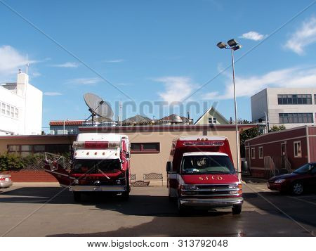 San Francisco, California - November 29, 2008: Sffd Red Firetruck And Ambulance Van Parked At Fire S