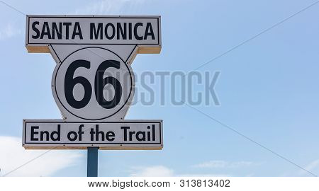 Route 66 Santa Monica, End Of The Trail. White Color Road Sign At Santa Monica Pier, Blue Clear Sky
