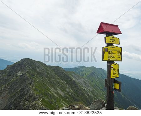 Trail Signpost At Top Of The Peak Banikov At Western Tatra Mountains Or Rohace. Sharp Green Mountain