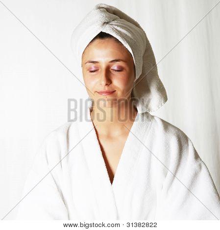 Woman Meditating In Bathrobe