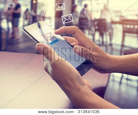 Hand Of Male Using Mobile Phone To Sending E-mail Message With Email Symbol And Envelope Icon. Email