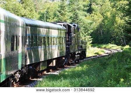 New York State, Usa - Jul. 3, 2010: Adirondack Scenic Railroad Train In Adirondack Mountains Between