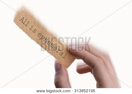 All Is Ephemeral Wording Written On Torn Notepaper In Hand