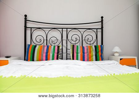 Colorful cozy bedroom in a modern apartment - booking accommodation poster
