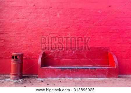 Copenhagen, Denmark - January 14, 2017: Red wall, red bench and red trash bin on the Red Square in Superkilen Park in Norrebro district. poster