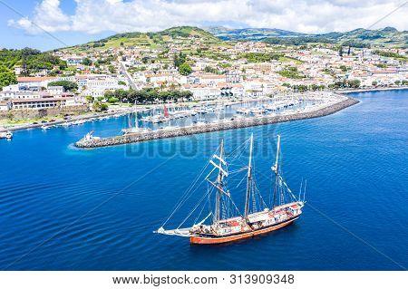 Horta, Portugal - Jul 16 2019: Aerial View Of Three Masted Schooner Sailing Vessel Buona Onda On Roa