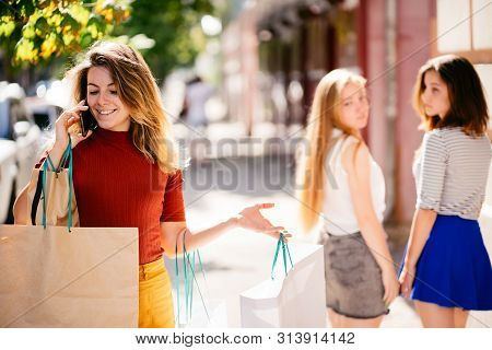 Stylish Beautiful Confident Woman With Many Shopping Bags In Hands Walking In The Street Attracting