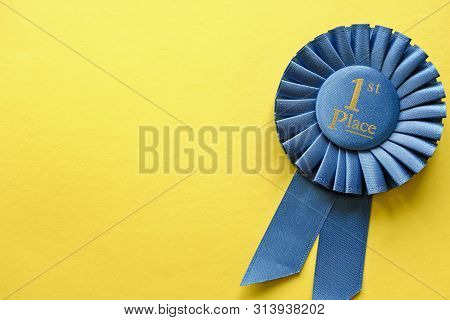 Blue Ribbon Rosette For The First Placed Winner Of A Race, Championship Or Competition Over A Yellow