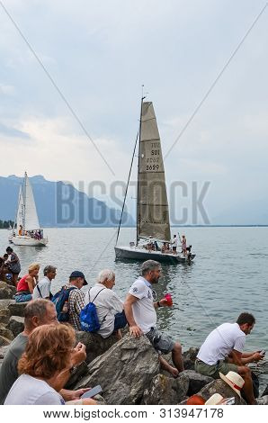 Vevey, Switzerland - July 26 2019: Crowd Watching Sailboats During Fete Des Vignerons 2019. Traditio