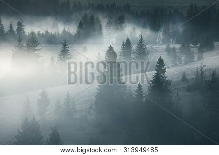 Majestic Landscape Of Summer Mountains. A View Of The Misty Slopes Of The Mountains In The Distance.