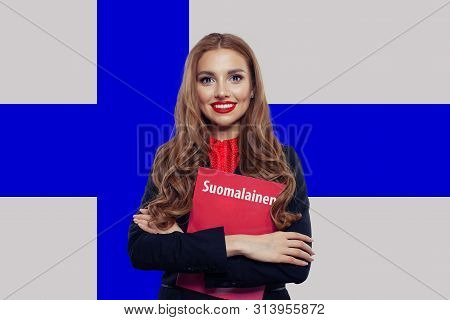 Young Woman Smiling And Posing Against The Finnish Flag Background. Finnish Language School And Trav