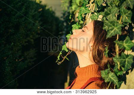 Enjoy Warmth. Woman Enjoy Sunny Day Outdoors. Autumn Season Concept. Pretty Woman Sun Tanning Nature