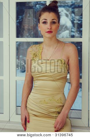 Beautiful Girl In A Dress By The Window
