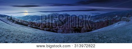 Beautiful Panoramic Landscape In October At Night. Meadow In Weathered Grass Trees In Fall Foliage.
