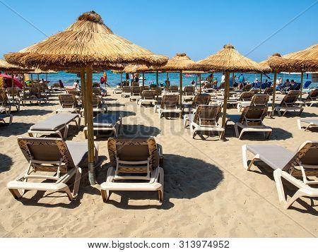 Malia, Crete, Greece - Juni 18, 2019: Sunbeds At The Beach In Malia On Crete, Greece