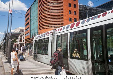 Lyon, France - July 14, 2019: Tram Entering The Tram Stop Of Lyon Part Dieu Train Station. It Is A P