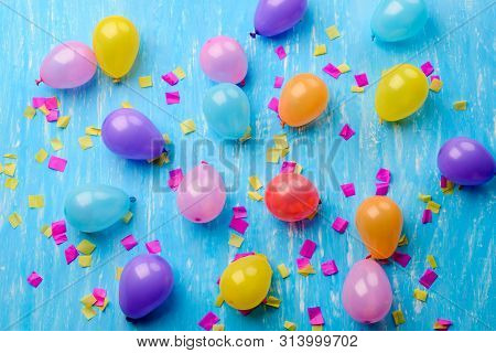 Many Baloons On A Blue Background. Multi-coloured. Screen Saver Or A Background.