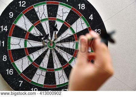 Man Throws Darts In The Game Of Darts.