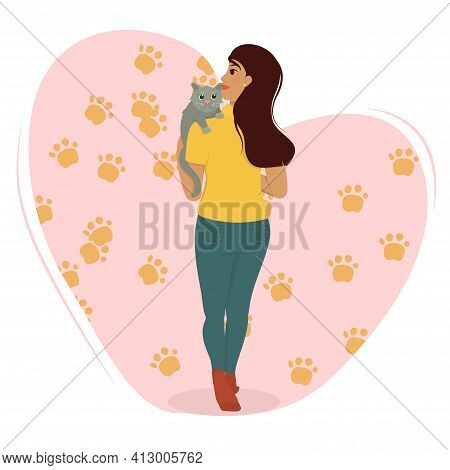 A Young Brunette Woman Holds A Gray Cat In Her Arms. The Concept Of Happy Pet Owners And Love For An