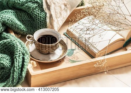 Coffee In Bed, Romantic Morning. Flowers In A Vase, An Open Book And A Cup Of Coffee On A Wooden Tra