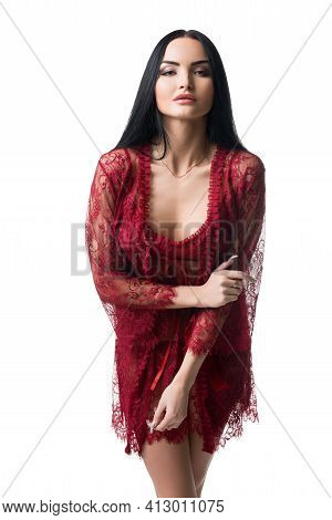 Charming Slim Woman In Lace Peignoir Looking At Camera
