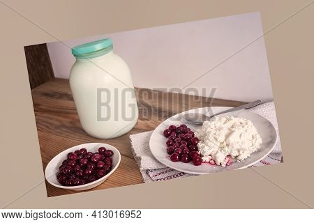 On The Wooden Table Is A Glass Jar Of Milk, A Plate Of Cottage Cheese And Cherries. Front View, Copy