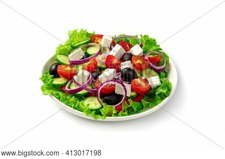 White Plate With Fresh Greek Salad Isolated On A White Background. Side View, Close-up.