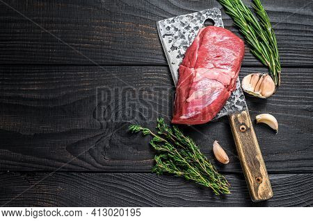 Fresh Raw Veal Chop Meat Steak On A Meat Cleaver. Black Wooden Background. Top View. Copy Space