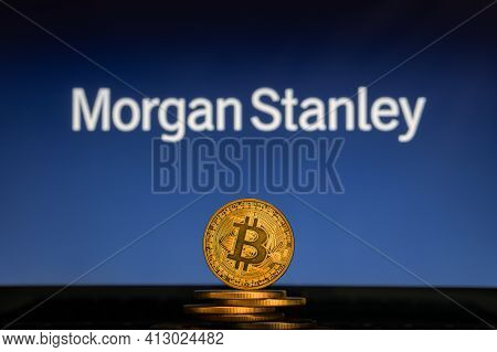 Bitcoin On A Stack Of Coins With Morgan Stanley Logo On A Laptop Screen.