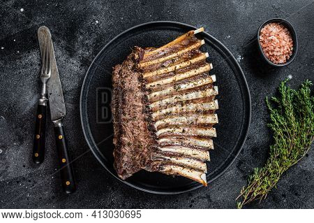 Bbq Grilled Rack Of Lamb Mutton Ribs Chops On Plate With Thyme. Black Background. Top View