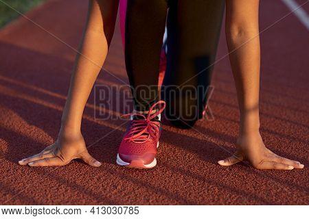 Little Girl Runner Standing In Start Position Before The Sprint