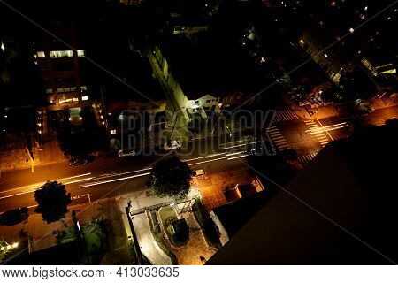 Aerial View Of A Busy Avenue In The City Of São Paulo At Night. With Lights On, Perspective And Nigh