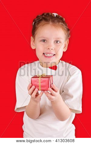 Little Girl With A Gift For Valentine's Day