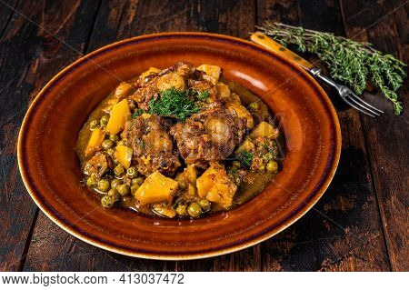 Lamb Oxtails Ragout With Vegetables In A Rustic Plate. Dark Wooden Background. Top View