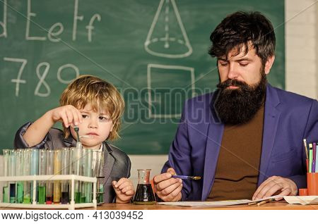 Knowledge Day September Holiday. Basic Level Chemistry Knowledge. Play With Liquids. Teacher And Boy