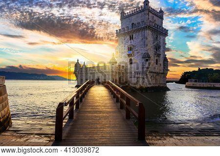 Torre de Belem (Belem tower) over sunset - famous landmark of Lisbon , Portugal