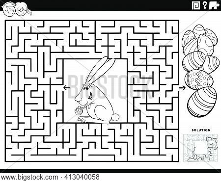 Black And White Cartoon Illustration Of Educational Maze Puzzle Game For Children With Easter Bunny