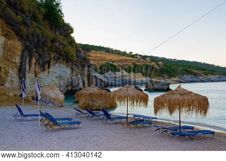 Picturesque Beach With Reed Umbrellas On The Island Of Zakynthos, Greece