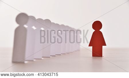 Gender Exclusion And Discrimination Concept With Row Of Cutouts Of Little Paper Men In A Row And Cut