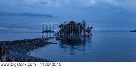 Beautiful Sunset At The Rocky Beach With A Famous Island On The West Pacific Ocean Coast. Taken In W