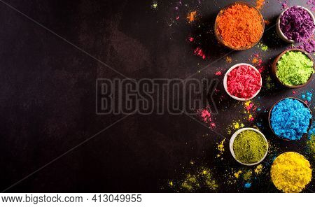 Happy Holi Festival Decoration.top View Of Colorful Holi Powder On Dark Background With Copy Space F