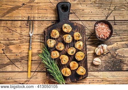 Bbq Seared Scallops With Butter Sauce On A Wooden Board. Wooden Background. Top View